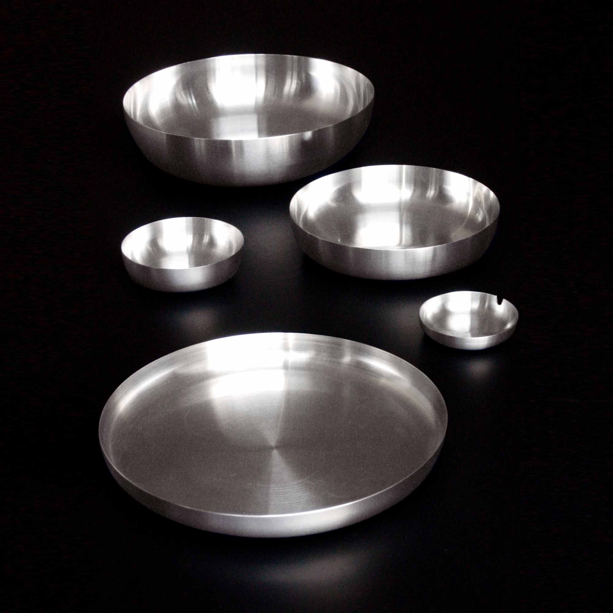 Tray Family (2001). A range of spun stainless-steel trays, bowls and an ashtray, designed for Alessi.