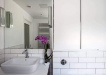 White contemporary bathroom enlivened with a hint of green and color