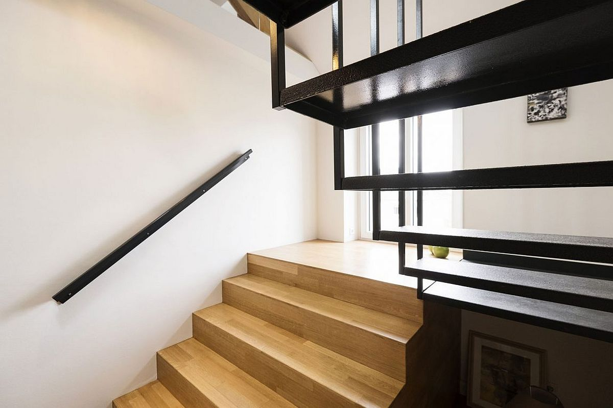 Wood and steel staircase connects the various levels of the house