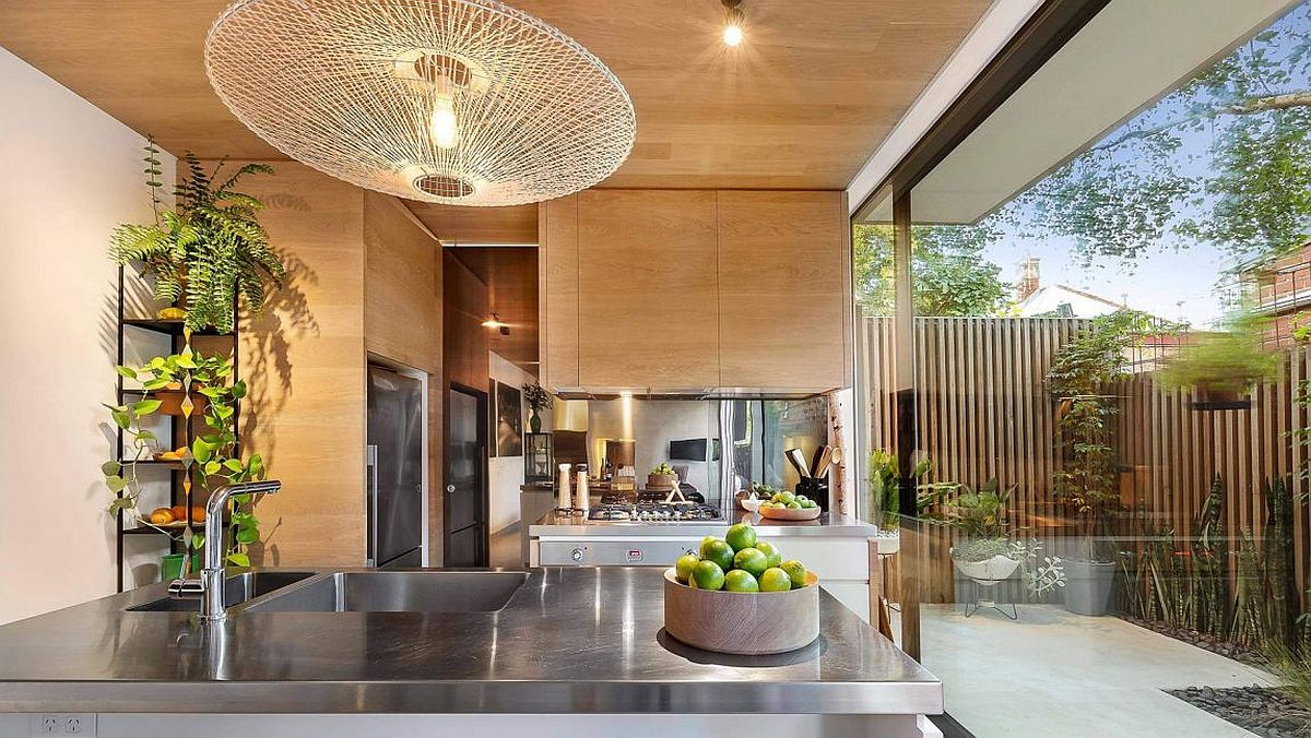 Wooden cabinets and kitchen shelves of the Aussie home