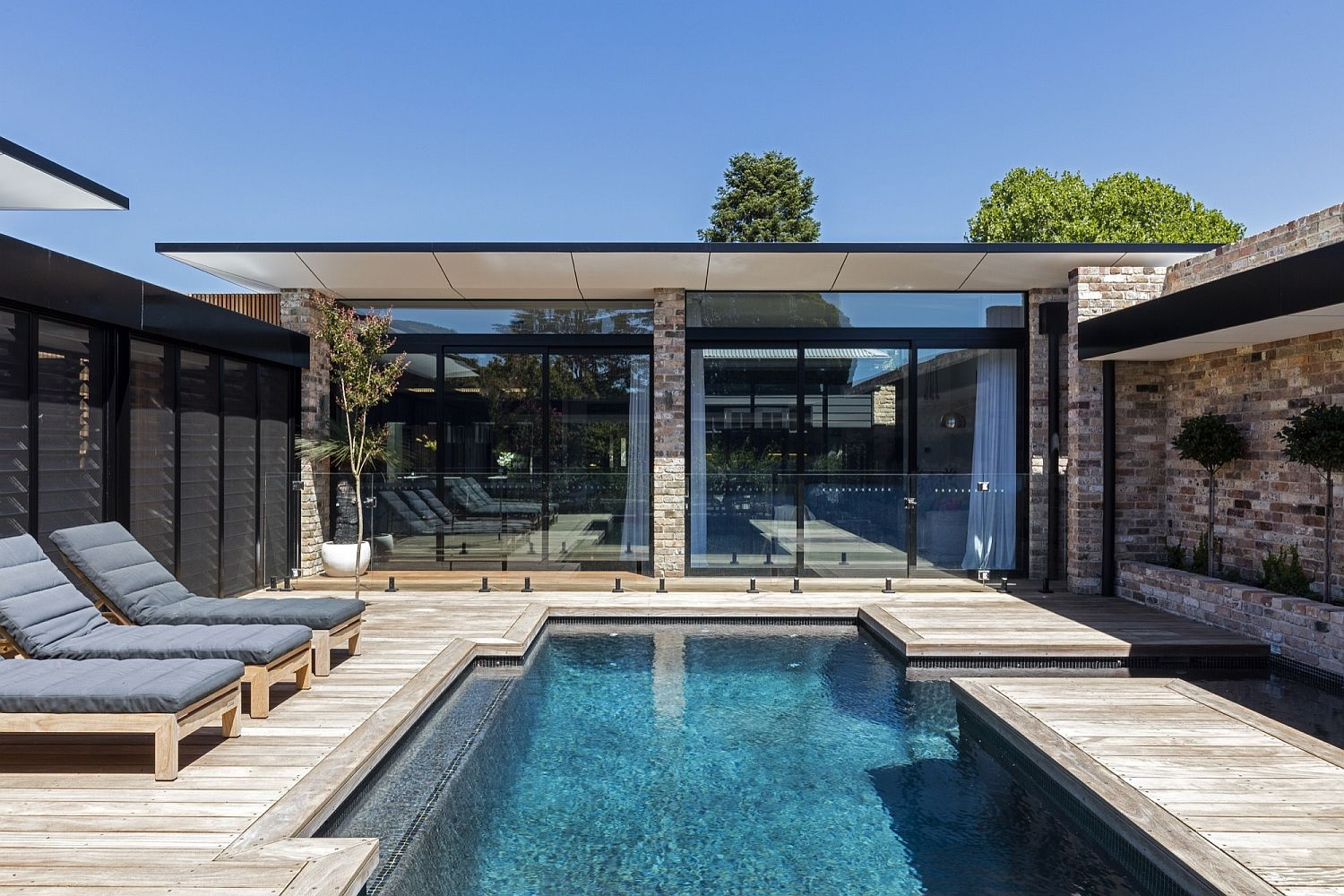 Wooden deck and pool area of the Bundaroo House