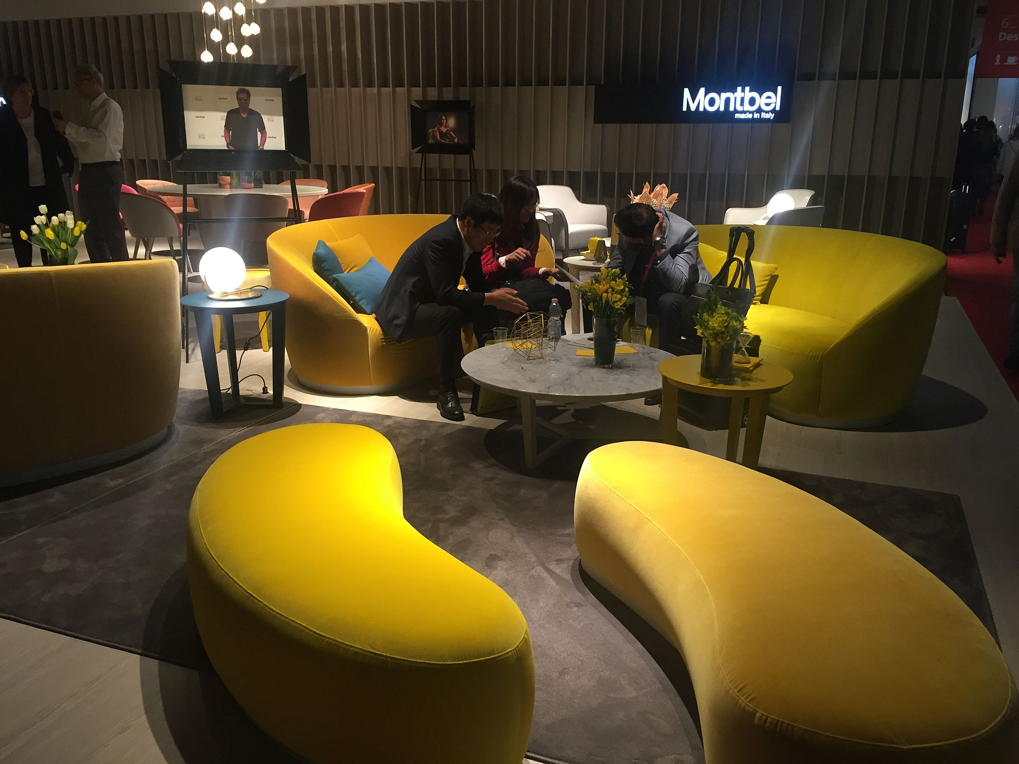 Yellow living room sofas coupled with smart modular setaing that doubles as a coffee table