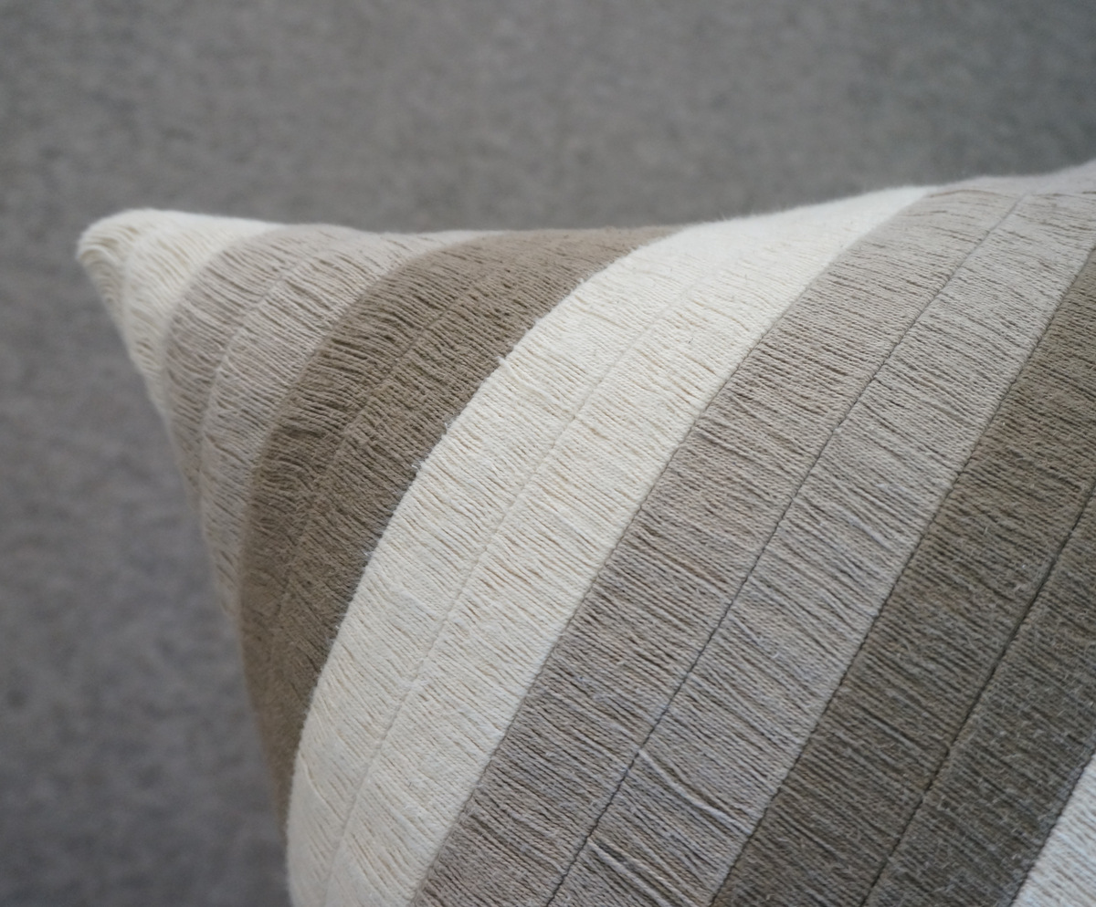 Beige striped pillow from Crate & Barrel