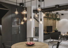 Black-becomes-the-color-of-choice-inside-the-industrial-kitchen-and-dining-area-217x155