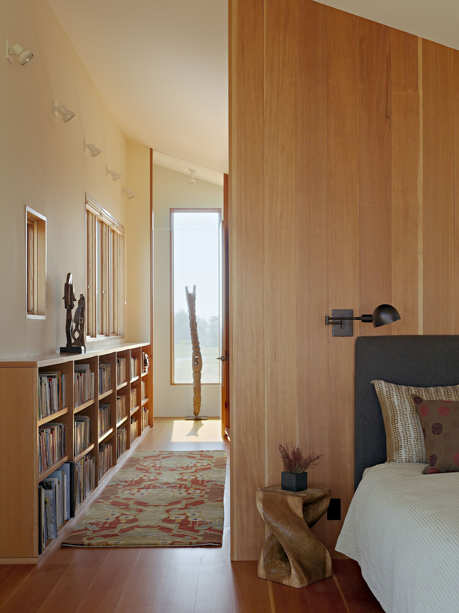 Bookshelves add color and style to the master bedroom