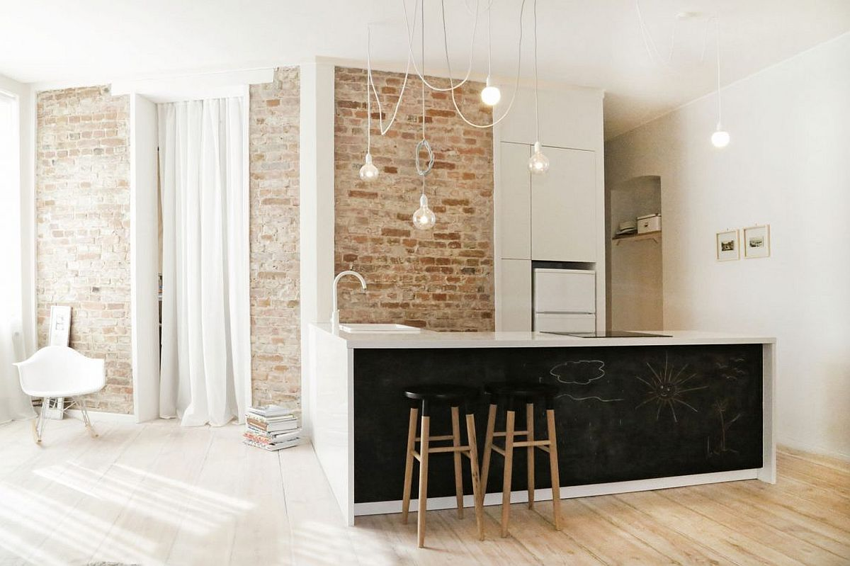 Bright and cheerful kitchen with exposed brick wall