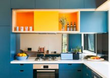 Bright-blue-cabinets-and-orange-bring-energy-to-the-modern-kitchen-217x155