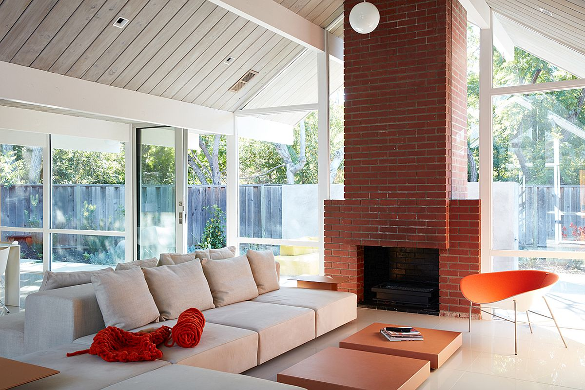 Classic brick fireplace inside the remodeled Eichler home
