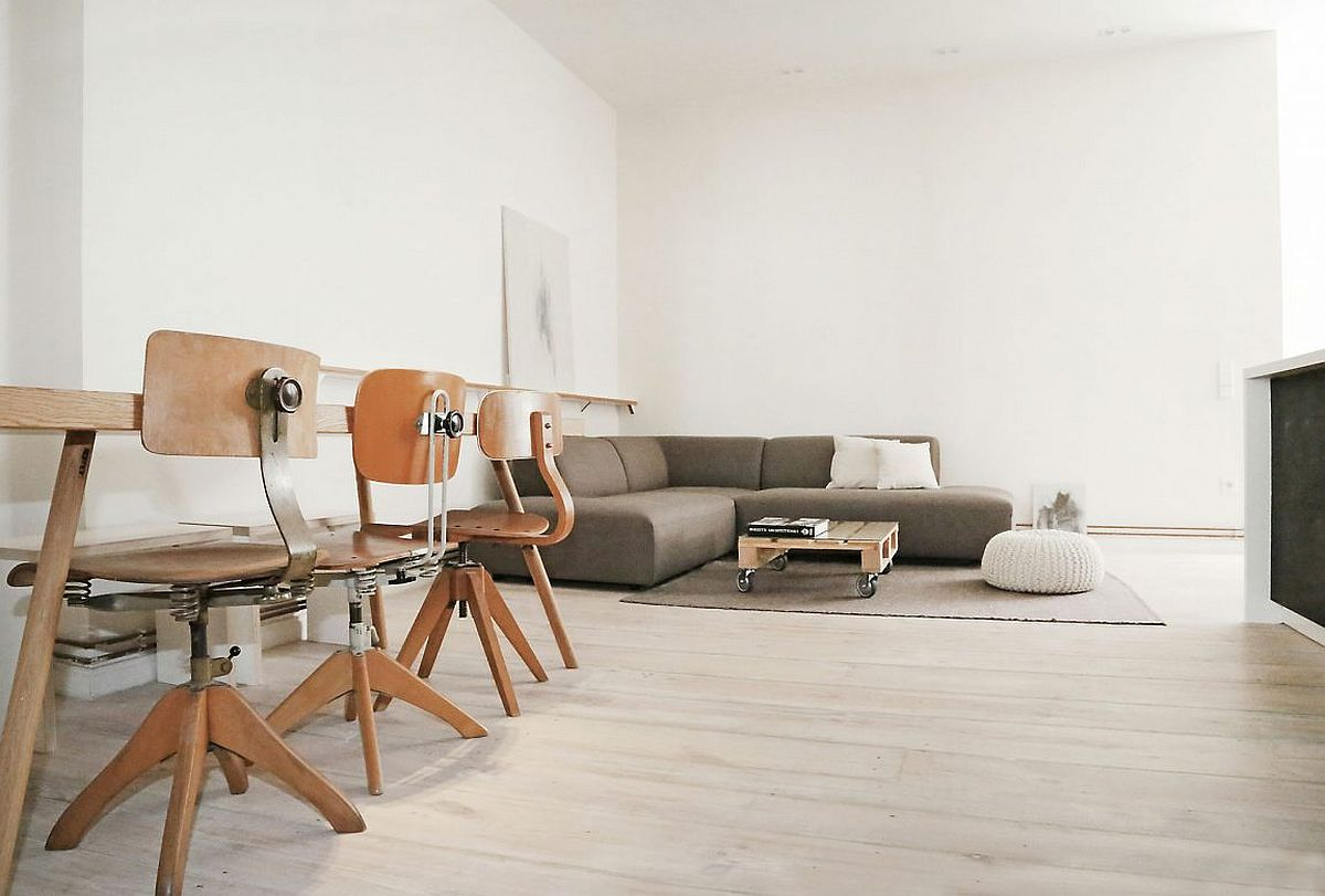 Coffee table on wheels at the heart of the living room of Berlin home