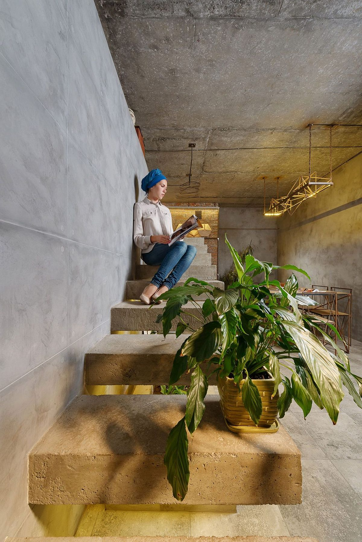 Concrete staircase in the living room becomes an aesthetic addition