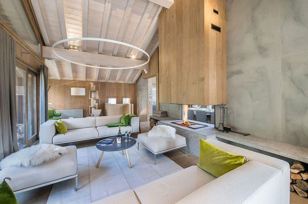 Contemporary fireplace at the heart of the modern living room of French Chalet