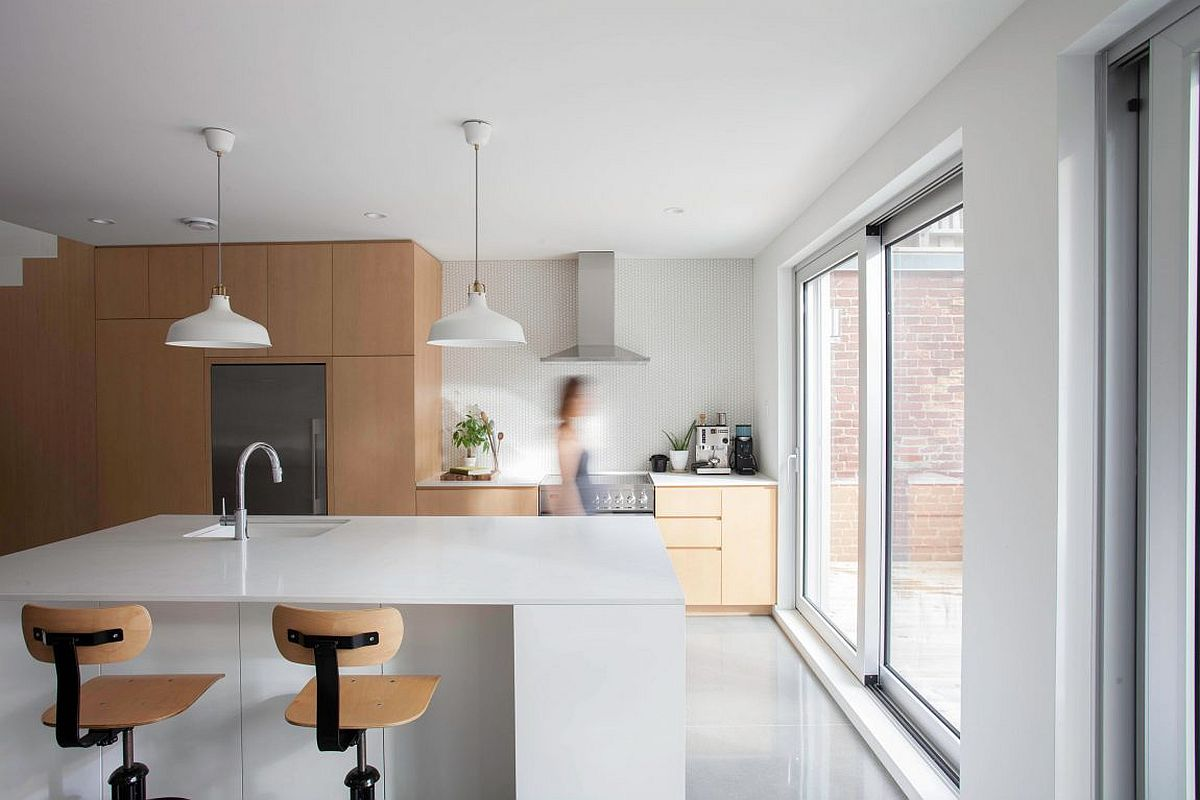 Contemporary kitchen in white with wooden cabinets and smart island