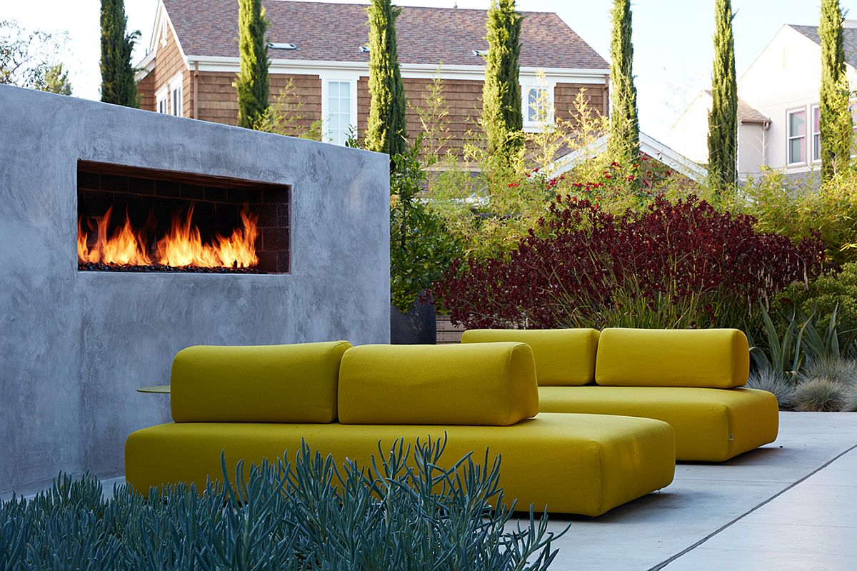 Contemporary outdoor hangout with bright yellow seating