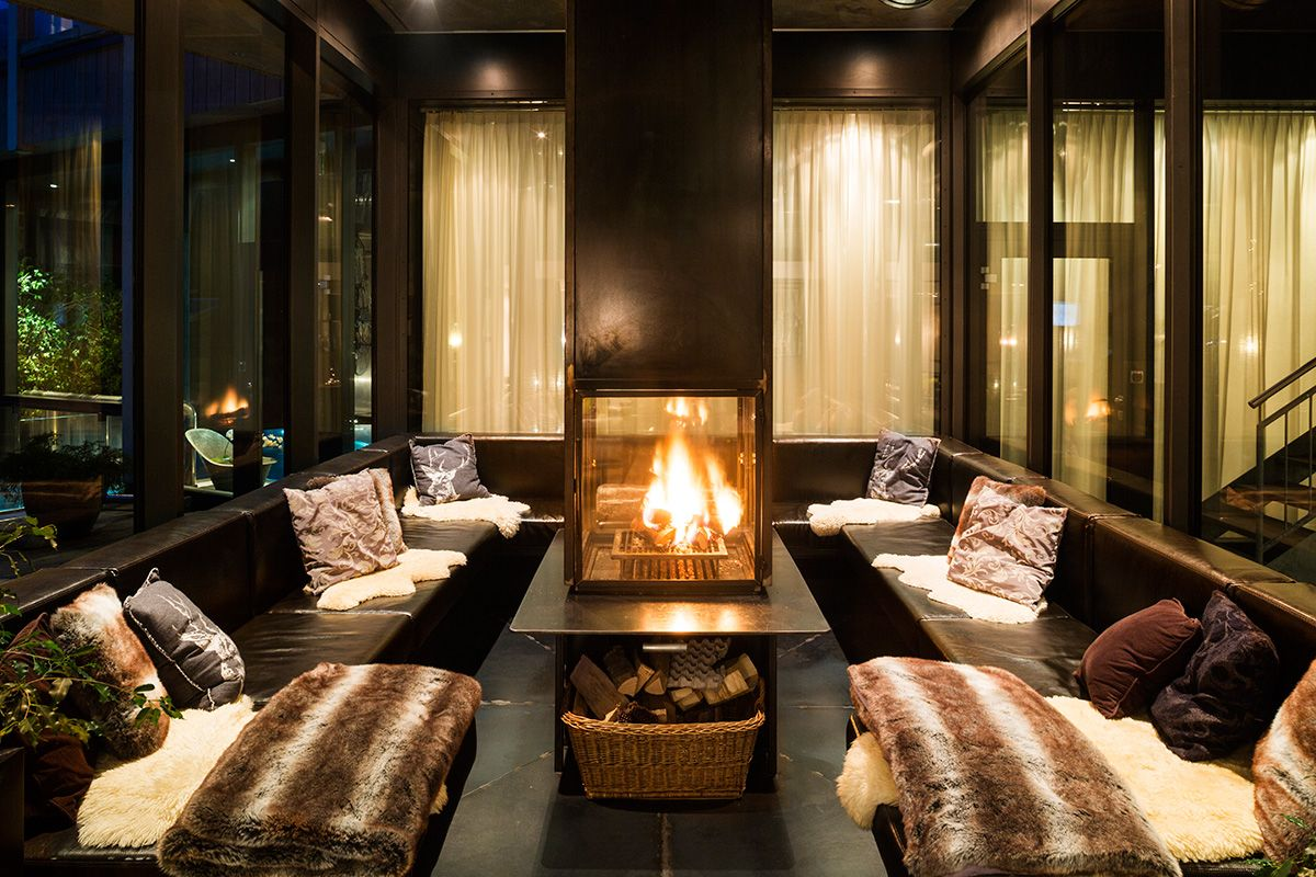 Cozy fireplace at the heart of the lounge provides all the warmth you need on a chilly day in the alps