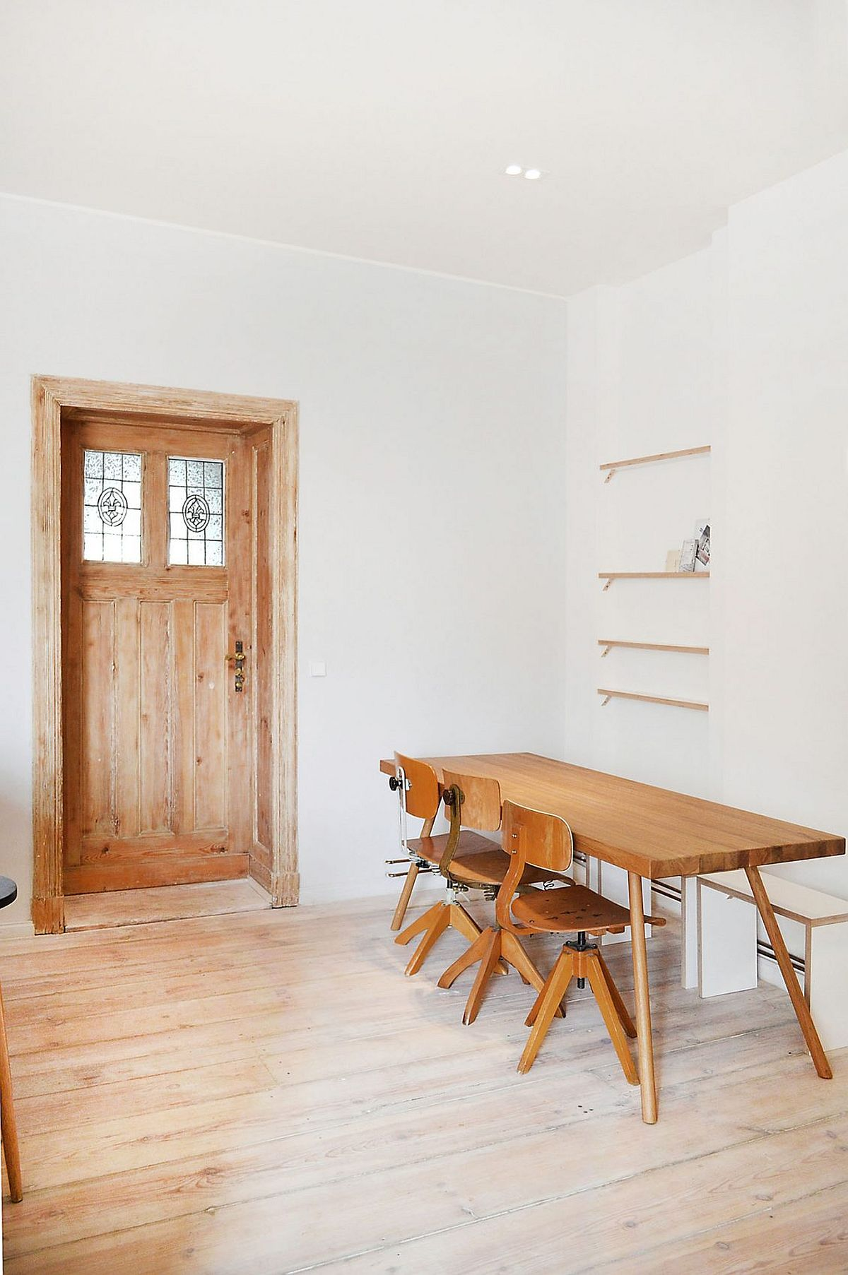Custom dining table and chairs of the Berlin Apartment