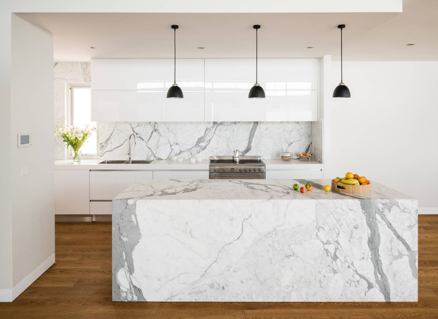 Dark pendant lights offer visual contrast in the white kitchen filled with marble goodness [Photo: Tim Turner for Urban Kitchens]