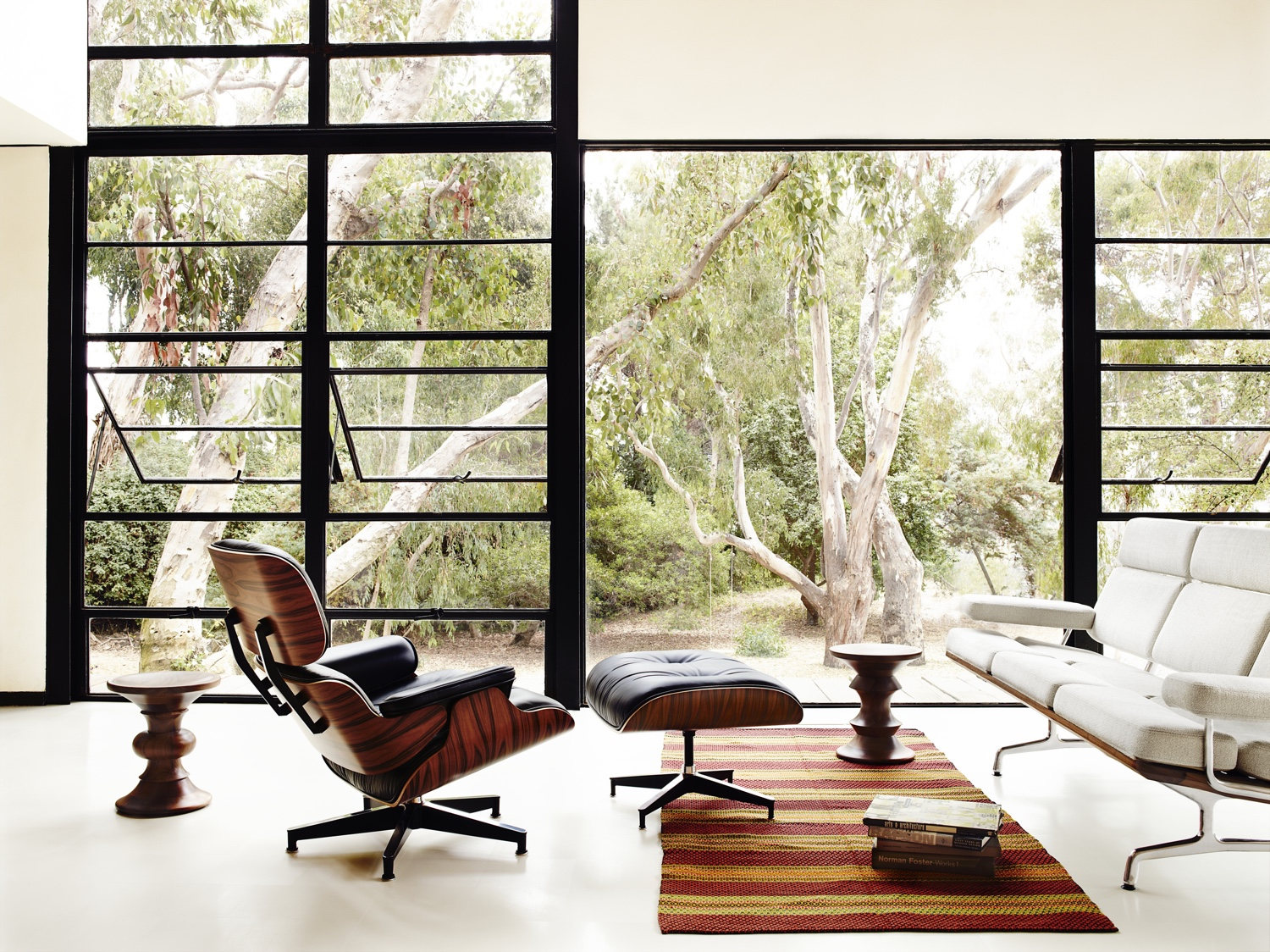 The Eames Lounge Chair and Ottoman in the Eames House (alongside the classic Eames sofa and Walnut Stools). Image © 2016 Herman Miller, Inc.