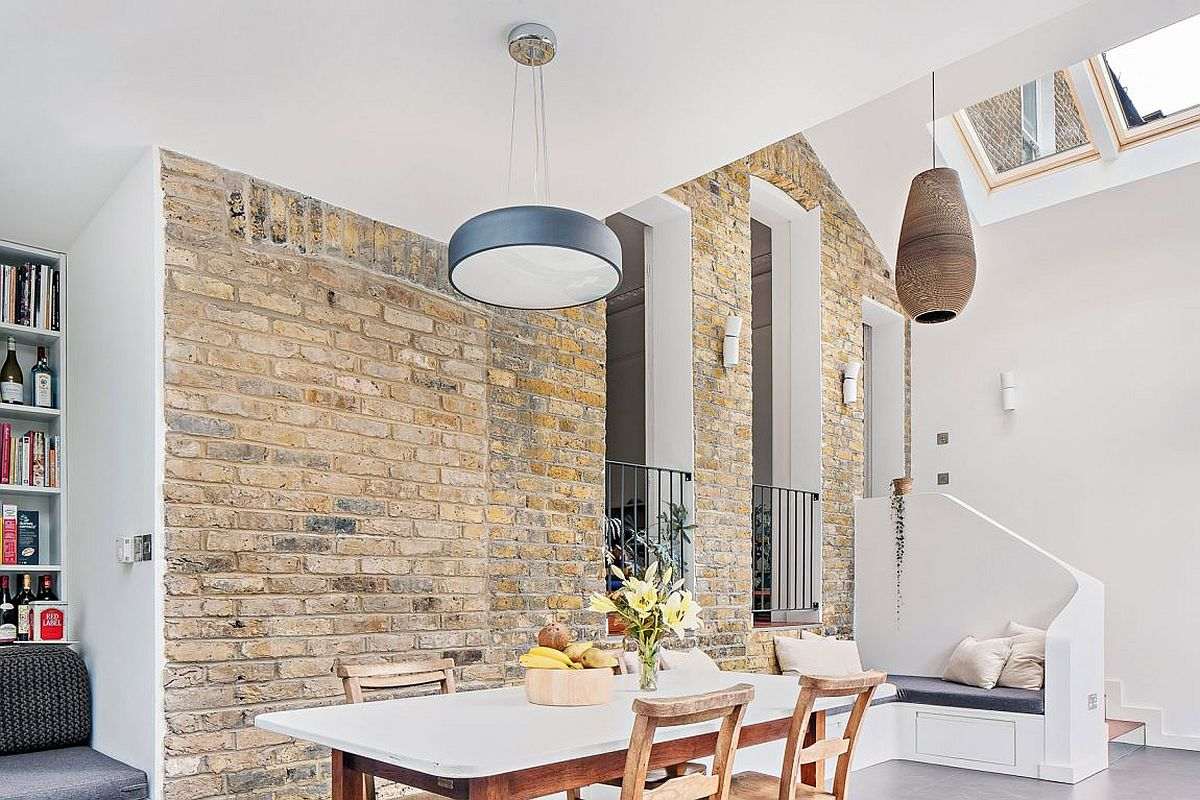 Existing brick walls of the home are worked into the overall design of the house