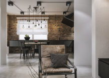 Exposed brick walls and Edison bulb lighting for the industrial dining room 217x155 Modern Loft in Kaunas: Industrial Style Wrapped in Unpretentious Lighting