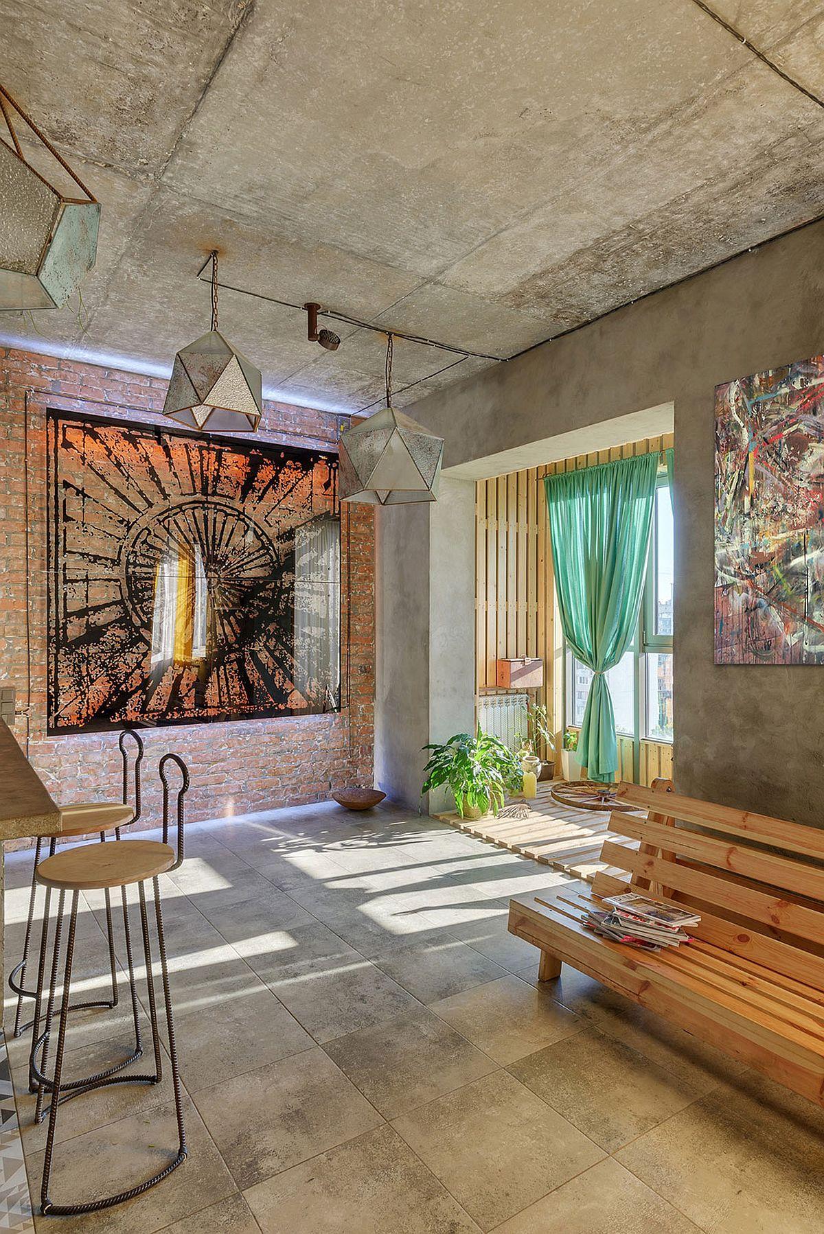 Exposed concrete, rebar, and metal oxide create a cozy and unique interior