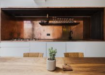 Exquisite kitchen workspace and backsplash in copper along with charred larch slats 217x155 An Indulgent Dip: This Terraced London Home Gets a Stunning Sunken Bath