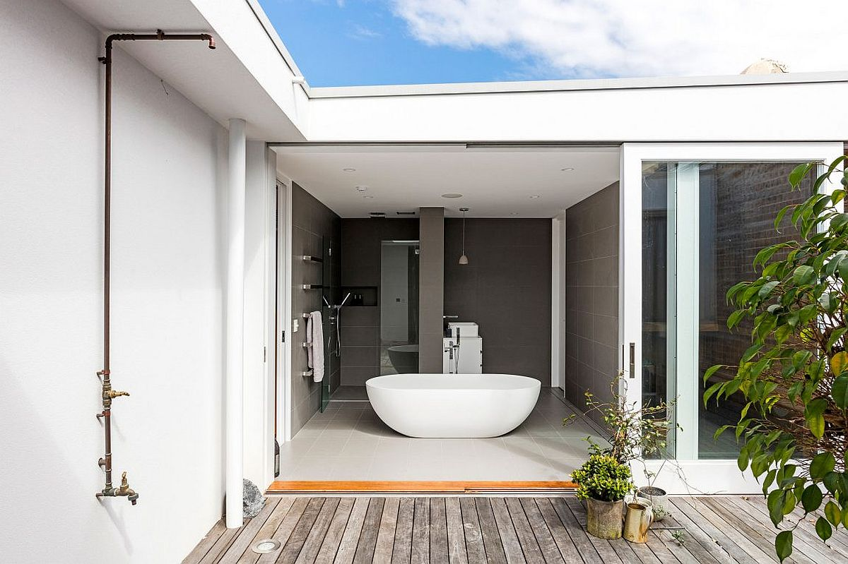 Fabulous bathroom in gray open to the private deck outside
