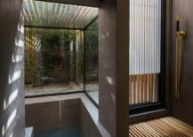 Fabulous-glass-wall-sunken-bath-with-slatted-larch-screen-217x155