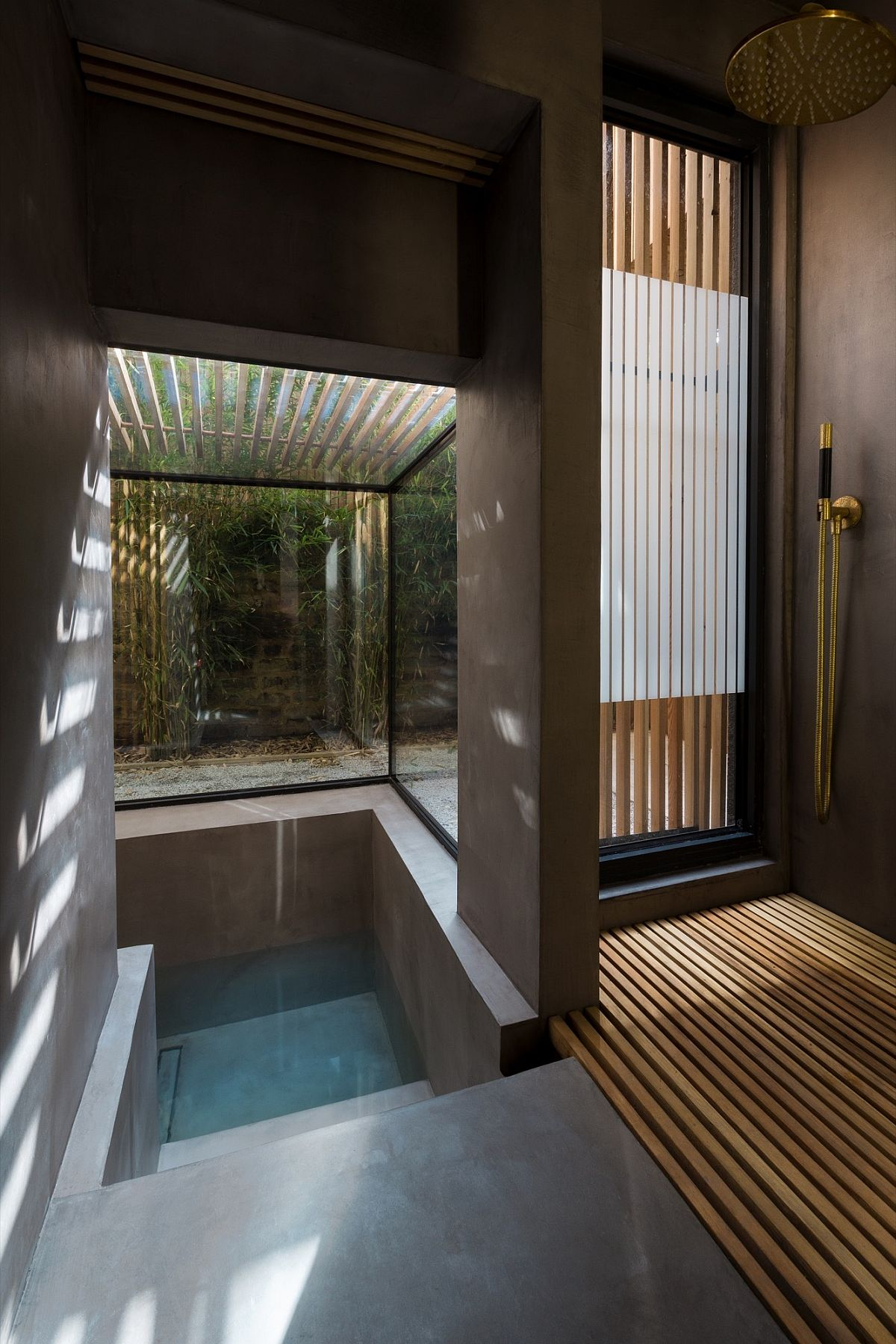 Fabulous glass wall sunken bath with slatted larch screen