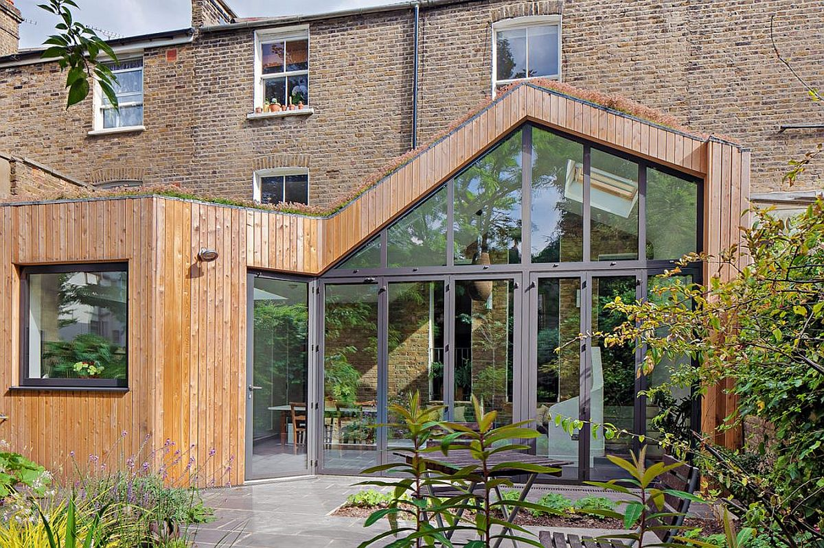 Folding doors connect the interior with the garden outside