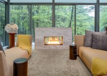 Glass-walls-bring-the-scenic-forest-landscaoe-indoors-217x155
