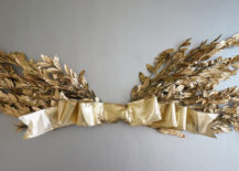 Gold-holiday-wall-hanging-with-a-bow-217x155