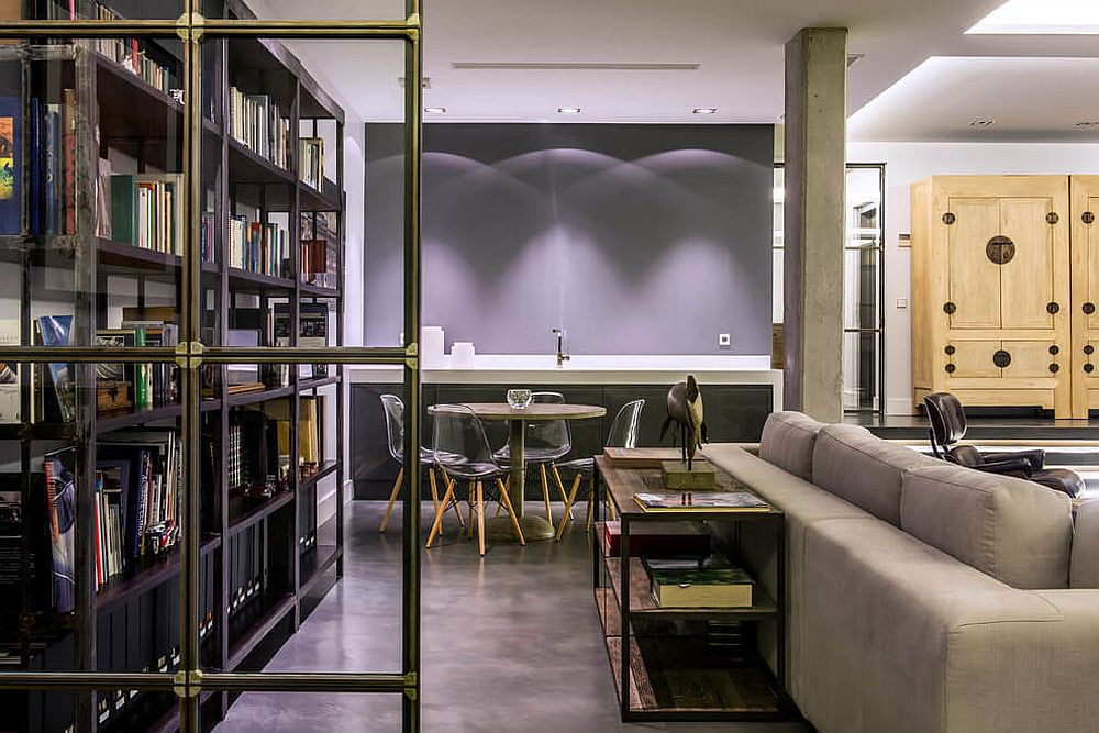 Gray color palette and metallic shelves give the interior a moern industrial vibe