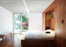 Head-of-the-bed-tucked-within-the-wooden-wardrobes-217x155