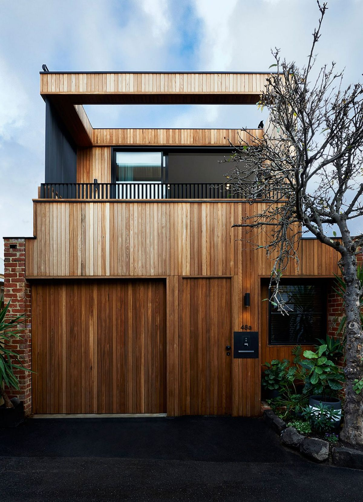 Heavy use of timber creates a lovely facade for the Y Residence in Melbourne