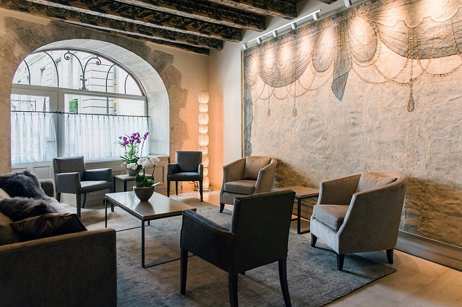 Historic appeal of Geneva's old town is reflected within the room of the Les Armures
