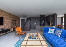 Industrial-living-room-with-brick-wall-and-bright-blue-couch-217x155