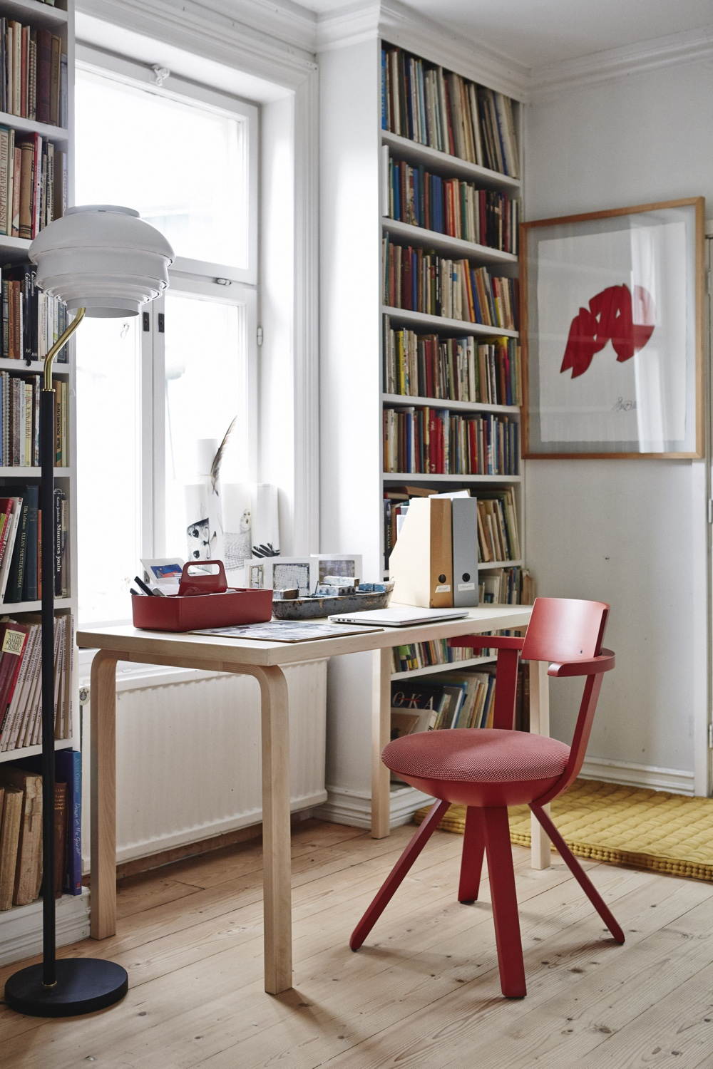 The KC002 Rival Chair (in red) was designed by Konstantin Grcic in 2014. The Vitra Toolbox (in 'brick') was designed by Arik Levy in 2010.