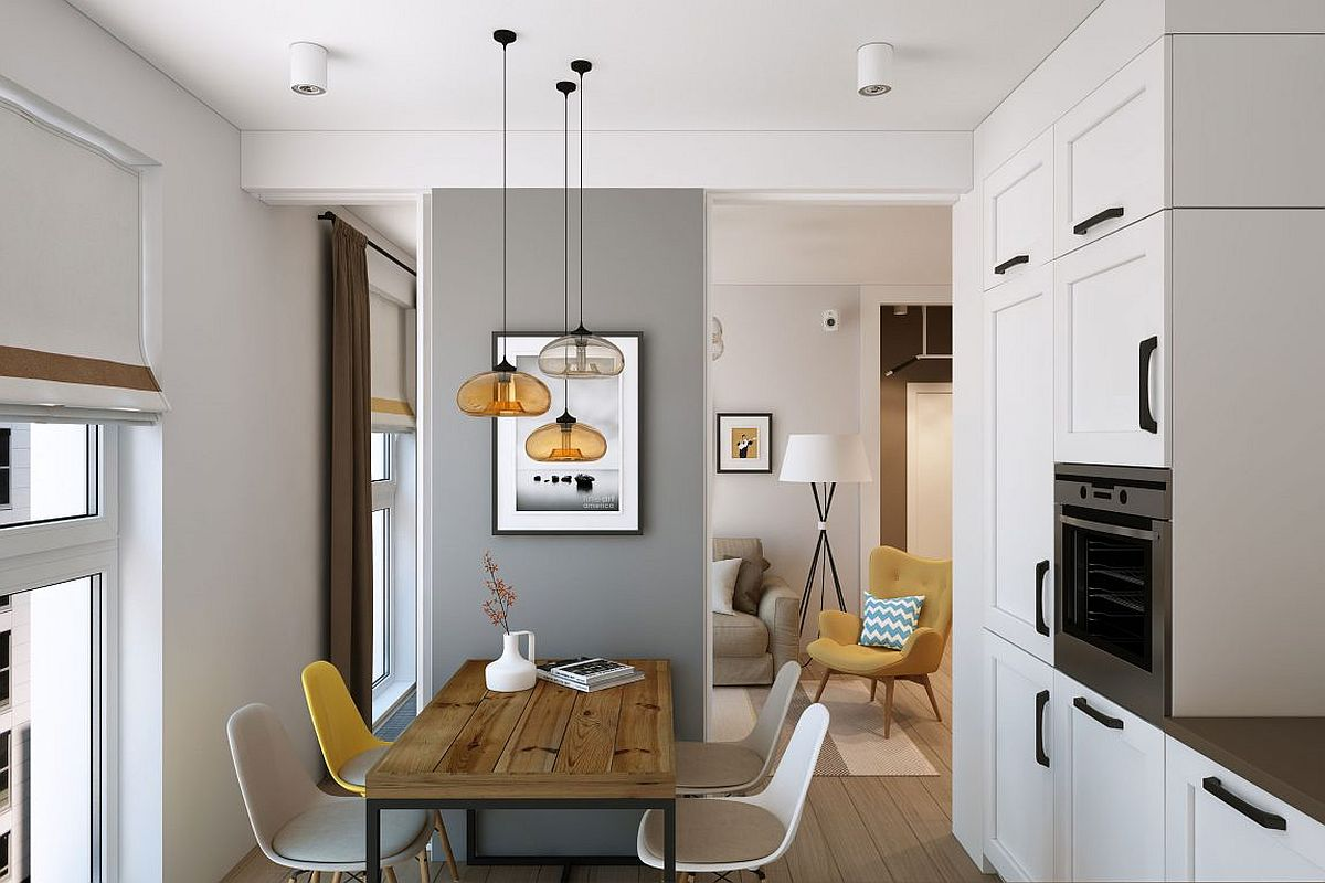Kitchen and dining in white and gray with beautiful pendant lighting