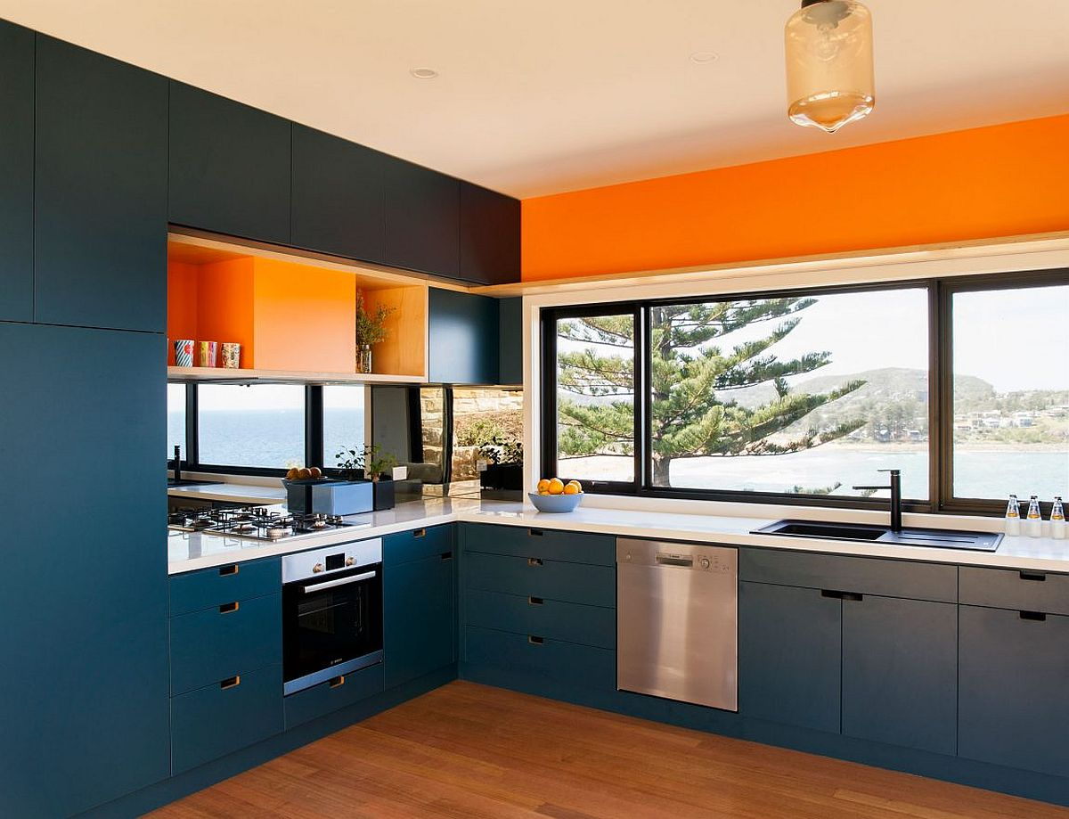 Kitchen in blue and orange with ocean view
