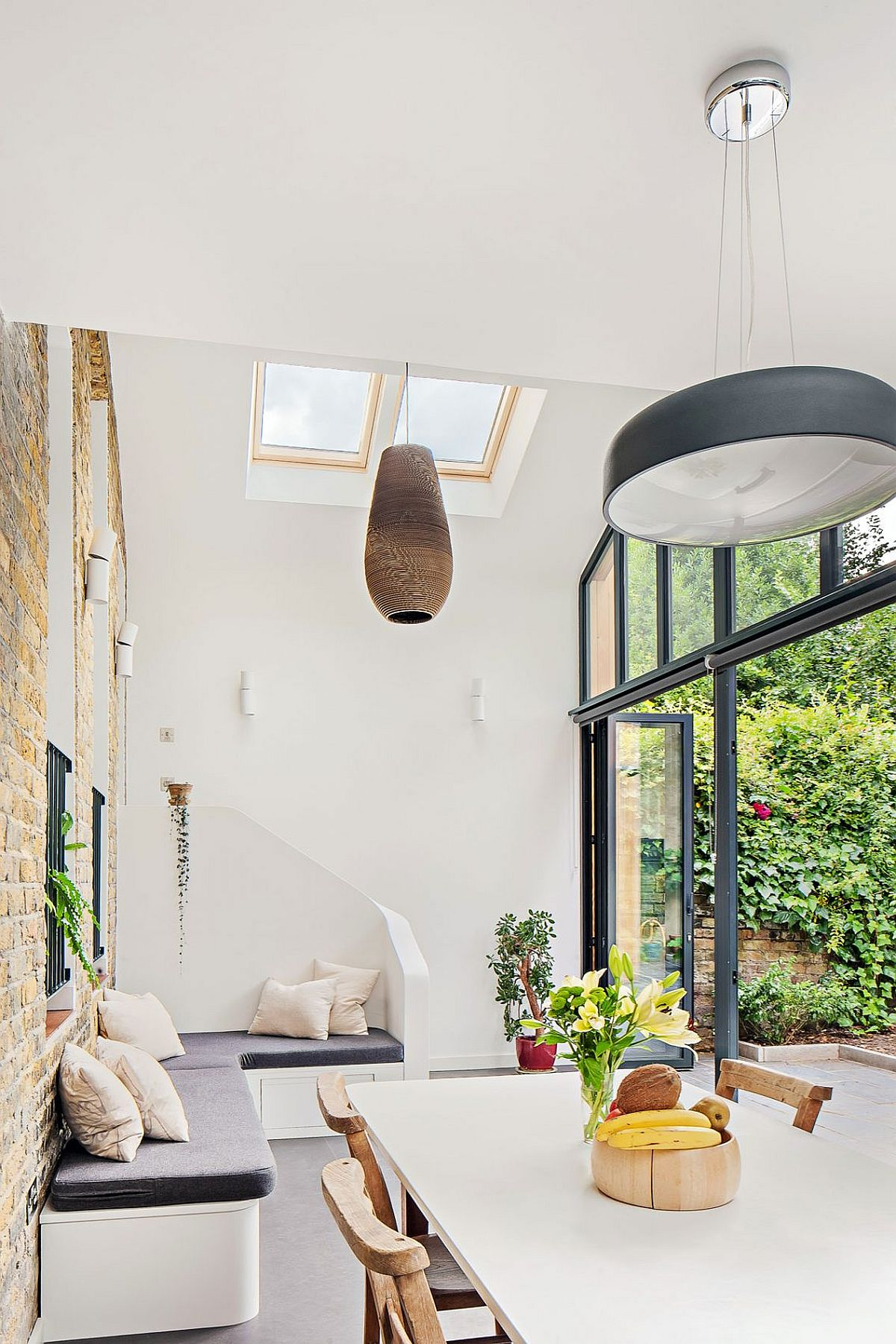 Large dining area of the London home with skylights