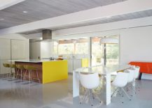 Large-kitchen-island-with-a-overhang-and-dining-space-next-to-it-217x155