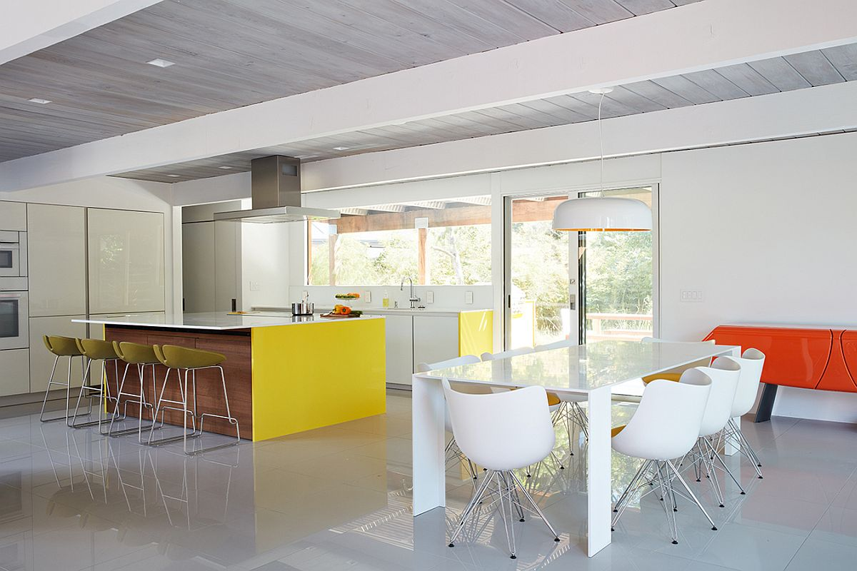Large kitchen island with a overhang and dining space next to it