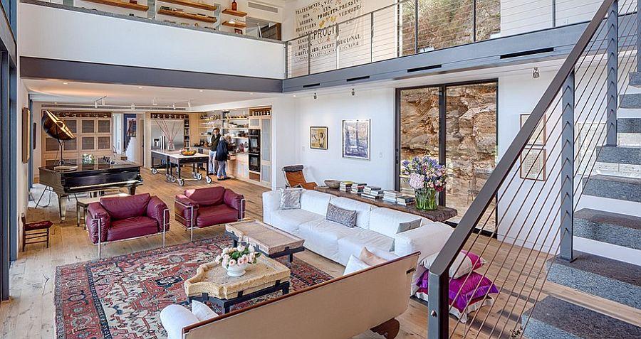 Living room of modern home on a narrow limestone bridge next to Lake Austin