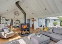 Living room with two sided fireplace of the South Hams Coastal Home 217x155 1960's Bungalow Altered into a Hypnotic Coastal Home with an Amazing View
