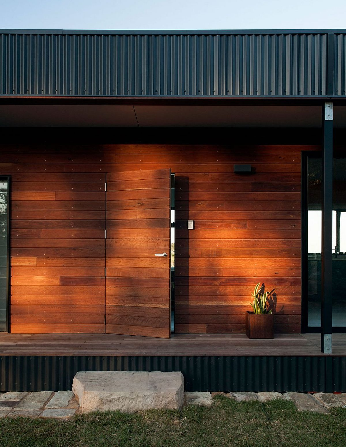 Locally sourced wood and metal shape the exterior of the modular house