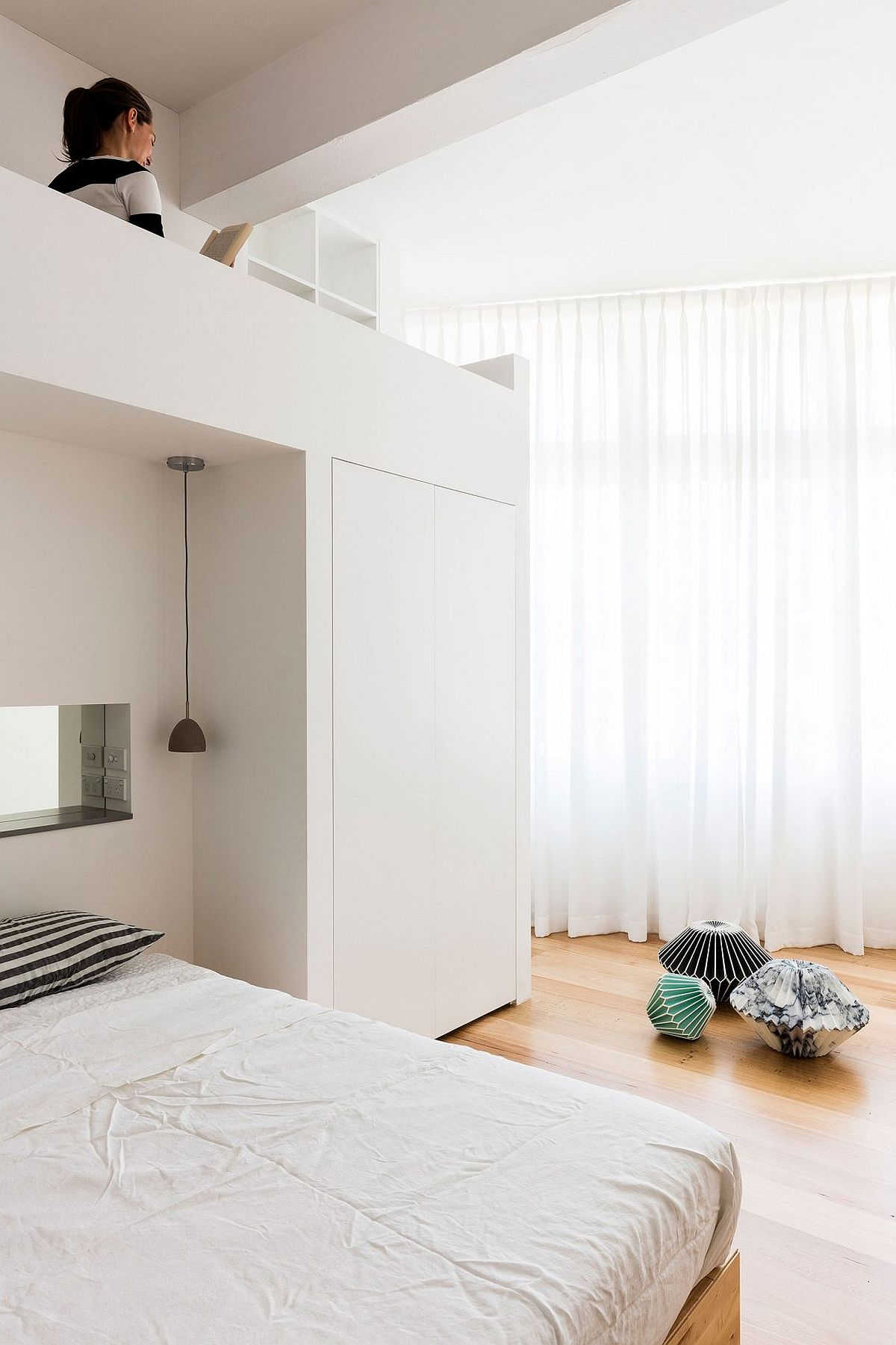 Loft bed in the small bedroom is a space-saver
