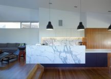 Marble-kitchen-island-complements-the-marble-backsplash-of-the-stylish-space-perfectly-217x155