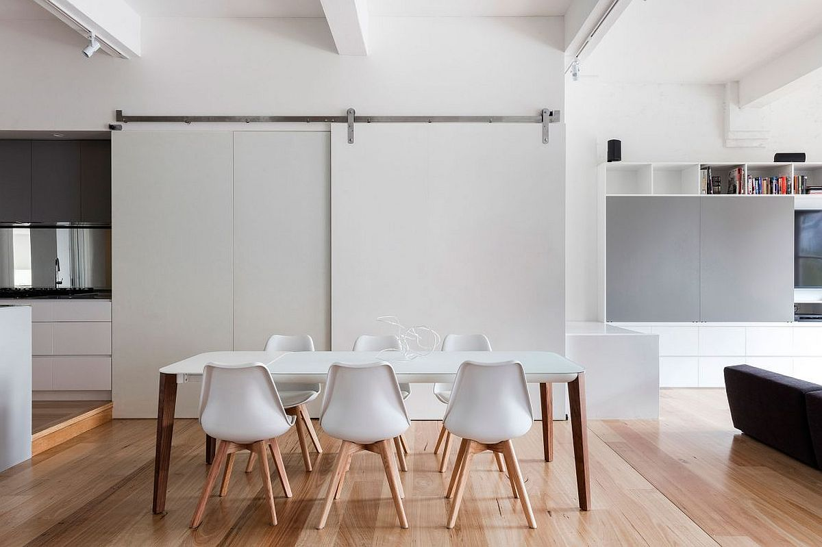 Minimal modern dining room in white with sliding barn style door
