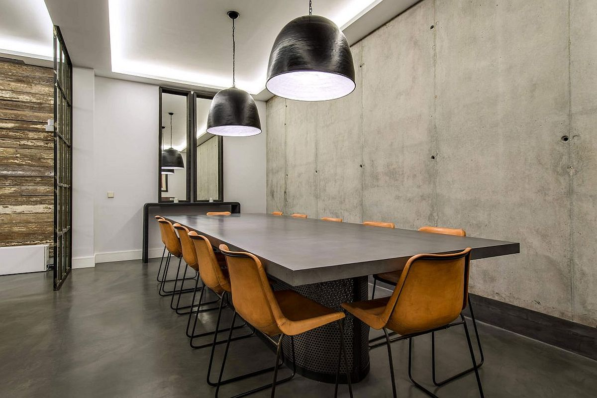 Mirrors add space and light to the industrial dining room