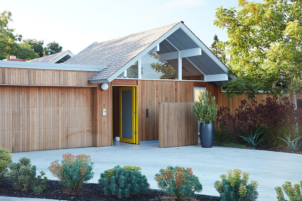 Modern Eichler home remodel clad in wood and glass